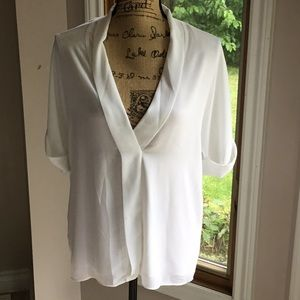 White Michael kors blouse.